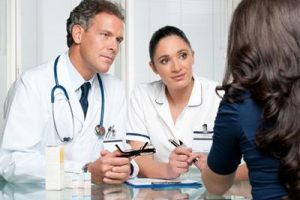 doctors and patient in discussion