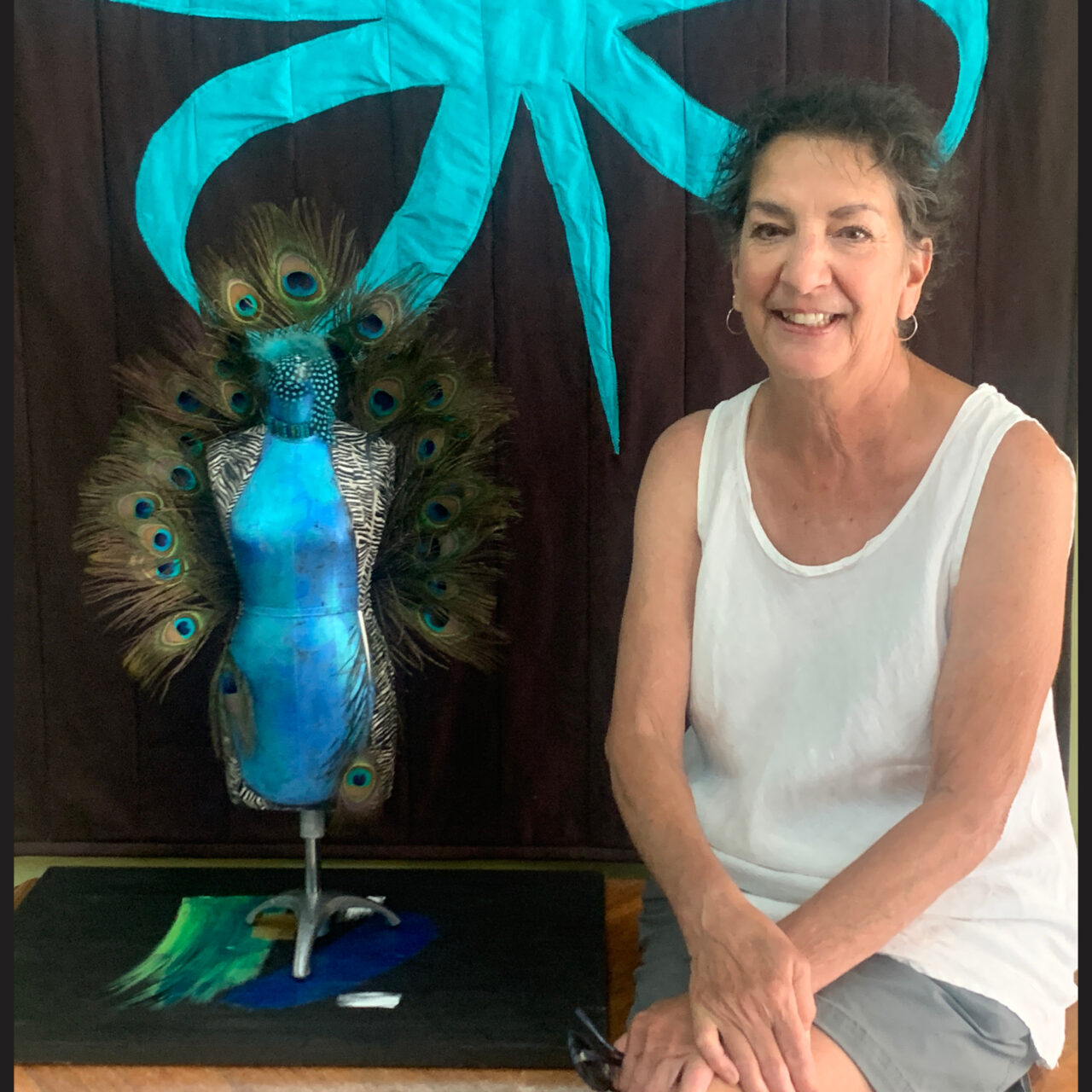 Smith with sculpture at office